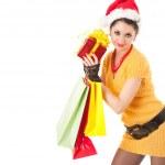 Fun santa woman with christmas gifts — Stock Photo