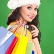 Fun santa woman with color packages — Stock Photo #9757844