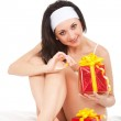 Cute woman with holiday gift box — Stock Photo