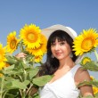 Young woman in the field of sunflowers — Stock Photo #9758376