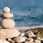 Balanced stones on the sea — Stock Photo #9758742
