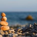 Balanced stones on the sea — Stock Photo #9758746