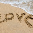 Stock Photo: I love you written in the sandy beach