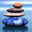 Stack of balanced stones on the sea — Stock Photo