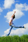 Happy young woman is jumping — Stock Photo