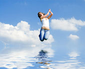 Pretty young woman is flying — Stock Photo
