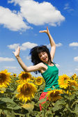 Expressive woman in the field of sunflowers — Stock Photo