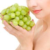 Woman with grape on the white background — Stock Photo