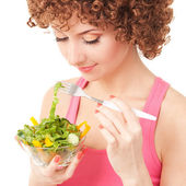 Fun woman eating the salad on the white background — Stock Photo