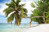 Fashion woman on the beach — Stock Photo