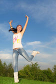 Pretty young woman is jumping — Stock Photo