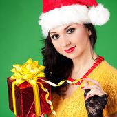 Fun santa woman with christmas gift — Stock Photo