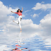 Pretty young woman jumping on water — Stock Photo