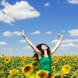 Fun woman in the field of sunflowers — Stock Photo #9864279