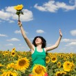 Happy girl in the field of sunflowers — Stock Photo #9864280