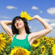 Happy woman in the field of sunflowers — Stock Photo #9864282