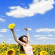 Fun woman in the field of sunflowers — Stock Photo #9864283