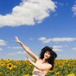 Woman in the field of sunflowers — Stock Photo #9864284