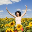 Fun woman in the field of sunflowers — Stock Photo #9864286