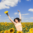 Woman in the field of sunflowers — Stock Photo #9864289