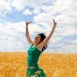 Pretty woman in golden wheat — Stock Photo