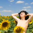 Fun woman in the field of sunflowers — Stock Photo #9864293