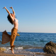 Happy young woman dance in the beach — Stock Photo #9864321