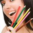 Young woman with varicoloured pencils - Stock Photo
