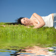 Happy young woman rest on the green grass — Stock Photo #9864637