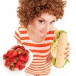 Fun woman with strawberry and sandwich on the white background — Stock Photo