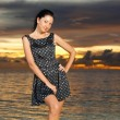 Fashion woman on the sea sunset background - Stock Photo