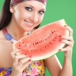 Stock Photo: Fashion woman with watermelon on the green background