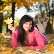 Young pretty woman rest in the autumn park — Stock Photo