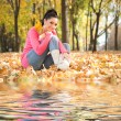 Young pretty woman rest in the autumn park - ストック写真