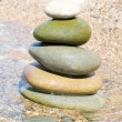 Balanced stones on the water — Stock Photo