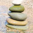 Balanced stones on the water — Stock Photo