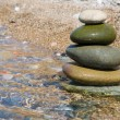 Stock Photo: Balanced stones on water