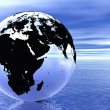 Globe in ocean - Stock Photo