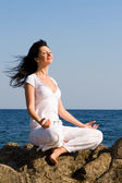 Young woman meditation in the beach — Stock Photo
