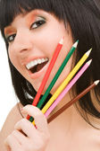Young woman with varicoloured pencils — Stock Photo