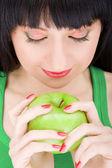 Sweet girl with apple — Stock Photo