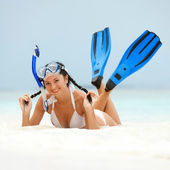 Happy woman with snorkeling equipment on the beach — Stok fotoğraf