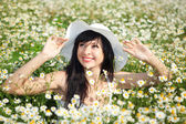 Happy woman in the daisy field — Stock Photo