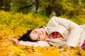Young pretty women rest on the autumn leaf — Stock Photo