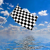 Waving a checkered flag on sky background — Stock Photo