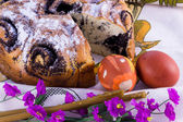 Easter cake, flowers and candles — Stock Photo