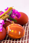 Easter eggs, candles and flowers — Stock Photo