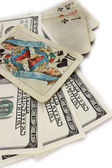 Money dollars and old playing cards — Stock Photo