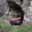Abandoned car in a cave — Stock Photo