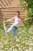 Funny girl in a field of daisies — Stock Photo